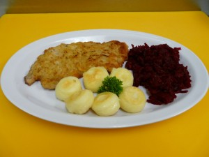 Pork cutlet with dumplings and red beets